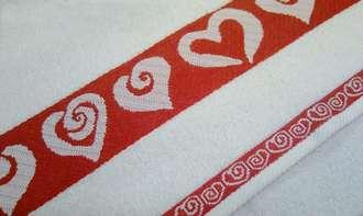 Махровое полотенце с сердечками в бордюре